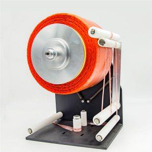 Distributeur de ruban de bobine